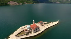 Island Gospa od Skrpjela. Touristic boats are in Adriatic sea, Montenegro Stock Footage