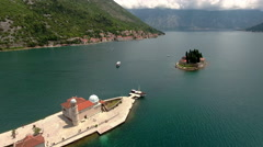 Flying over artificial island Gospa od Skrpjela and next to the Sveti Dordje Stock Footage