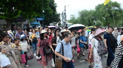 People and traveller walking cross over road at crosswalk at Wat Phra Kaew Stock Footage