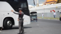 Blurred motion of police work take care traffic at front of Wat Phra Kaew Stock Footage