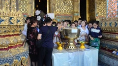 Traveller join the thai ceremony use lotus sprinkling with blessed water Stock Footage