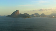 Aerial view of Sugar Loaf Mountain and Corcovado Hill at sunset, Brazil Stock Footage
