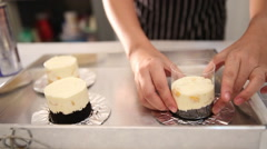 Hand wrapping plastic and foil around cheese cake tart - stock footage