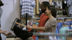4K Couple in clothing store paying for a purchase with credit card Stock Footage