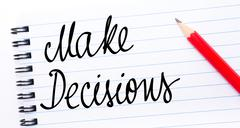 Make Decisions written on notebook page Stock Photos