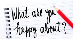 What Are You Happy About? written on notebook page - stock photo
