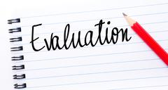 Evaluation written on notebook page - stock photo