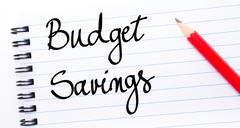Budget Savings written on notebook page - stock photo