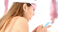 happy fwoman in swimsuits using smartphone, watching photos or news - stock footage