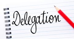 Delegation written on notebook page Stock Photos