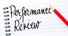Performance Review written on notebook page - stock photo