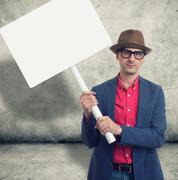 Trendy man holding protest sign Stock Photos