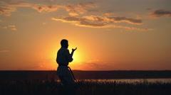 Silhouette of man training karate at sunset Arkistovideo