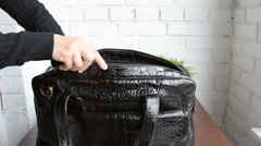 Woman packing her bag for business trip - stock footage