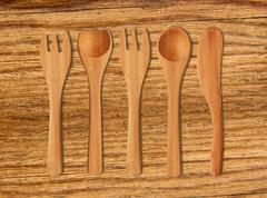 Wooden Kitchen Utensils on cutting board background - stock photo