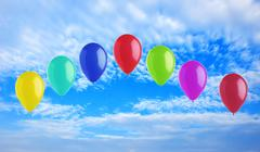 Colorful bright balloons on blue sky Stock Photos