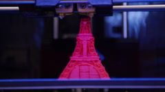 Technology - 3D printer making statue of Eiffel Tower Stock Footage