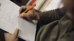 Man sit and underline words in list on sheet of paper in folder by pen. Writing Stock Footage