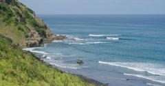Murawai Beach coastline in Auckland, New Zealand Stock Footage