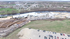 Lumber mill on the water - Timmins Ontario - Aerial Stock Footage