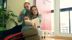 Lovely wife and husband spent time together near warm radiator on cold day Stock Footage