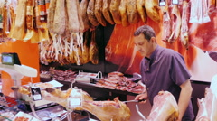 Barcelona, Spain - The man behind the counter of the seller runs Stock Footage