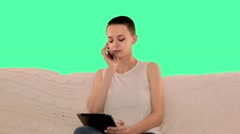 Beautiful bald girl, a girl with short hair brunette sitting on the couch and Stock Footage
