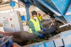 Worker is sorting the recyclable glass material and removing non recyclable t - stock photo