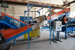 Conveyor belt and electromagnet equpment inside glass material recycling fact Stock Photos