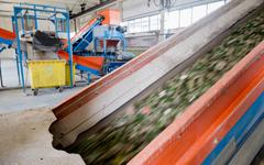 Conveyor belt and glass shredder equpment inside glass material recycling fac Stock Photos