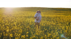 Father holding his little son on a field. Slow mo Stock Footage