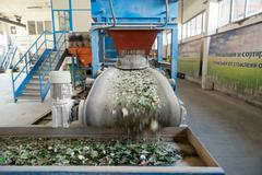 Conveyor belt and glass shredder equpment inside glass material recycling fac - stock photo