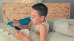 Beautiful bald girl, a girl with short hair brunette, with the tablet, tired and - stock footage