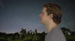 Man looking at the universe Stock Footage