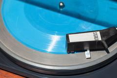 above view of headshell on blue flexi disc - stock photo