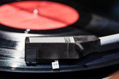 tonearm on vinyl record in old turntable - stock photo