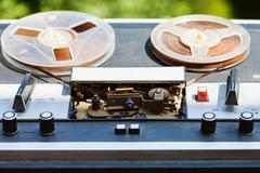 vintage reel-to-reel recorder outdoors - stock photo