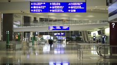 Hong Kong international airport navigation signages and travellers Stock Footage