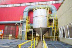 Acid tank with pipeline, part of the industrail process of a smelter, foundry - stock photo
