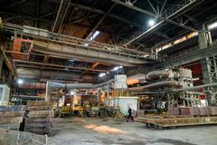 Industrial production shop with casting equipment in a smelter hall , foundry Stock Photos
