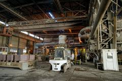 Working in production shop with casting equipment in a smelter hall , foundry - stock photo