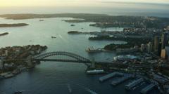 Aerial sunrise view of Sydney Harbor Bridge and Circular Quay Australia Stock Footage