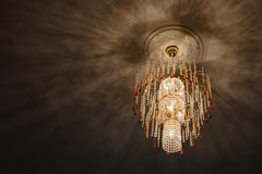 Selective focus of Crystal Chandelier , ceiling lights, black shadows Kuvituskuvat
