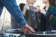 DJ spinning records at party - stock photo
