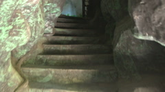 Stone Stairs to Light Exit in Artificial Caves in Park Stock Footage
