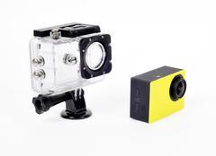 Small action camera and waterproof box Stock Photos