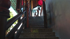 Upstairs along Wooden Gallery to Buddhist Temple Main Hall Stock Footage