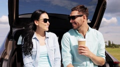 Happy couple with coffee at hatchback car trunk 11 Stock Footage
