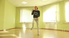 Attractive girl performs a modern dance in a dance studio - stock footage