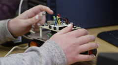 Students in high school learning robotics - stock footage
